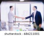 handshake of businessman with... | Shutterstock . vector #686211001