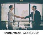 handshake of businessman with... | Shutterstock . vector #686211019