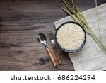 rice in a wooden spoon and rice ... | Shutterstock . vector #686224294