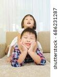 asian kids having fun at home   Shutterstock . vector #686231287
