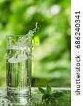 cool fresh water with ice and... | Shutterstock . vector #686240341