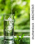cool fresh water with ice and... | Shutterstock . vector #686240365