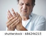 old man with finger pain | Shutterstock . vector #686246215