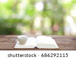 tea with white book at outdoor | Shutterstock . vector #686292115