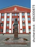 Small photo of BARNAUL, RUSSIA - JULY 2, 2015: A monument to academician Michael lisavenko on the background of the Altai state agrarian University.