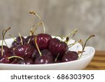 sweet cherry on a plate on...   Shutterstock . vector #686303905