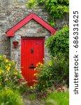 Red Door And Overgrown Flower...