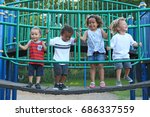 A Diverse Group Of Children Ar...