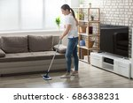 happy young woman cleaning the... | Shutterstock . vector #686338231