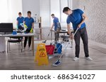 group of janitors cleaning the... | Shutterstock . vector #686341027