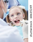 Child examines the dentist in the clinic - stock photo
