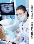 Physician and patient in dentistry - stock photo