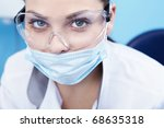 Doctor in a mask and goggles close-up - stock photo