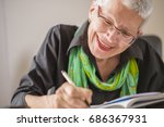senior old woman writing down... | Shutterstock . vector #686367931
