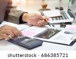 business man using calculator... | Shutterstock . vector #686385721