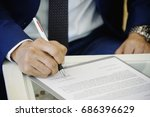 business man sign on document . ... | Shutterstock . vector #686396629