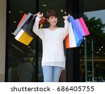 happy woman at the mall holding ... | Shutterstock . vector #686405755