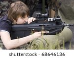 teenage boy aiming with the... | Shutterstock . vector #68646136