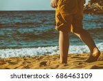 children's feet on the sand of... | Shutterstock . vector #686463109
