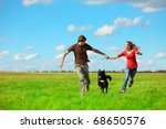 young happy lovers running with ... | Shutterstock . vector #68650576