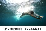 swimmer in flippers dives into ... | Shutterstock . vector #686522155