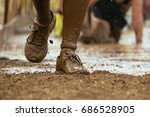 mud race runners passing under... | Shutterstock . vector #686528905