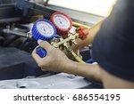 auto mechanic uses a pressure...   Shutterstock . vector #686554195