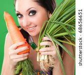 pretty girl with carrot and...