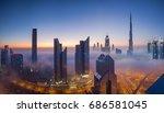 dubai skyscrapers covered in fog | Shutterstock . vector #686581045