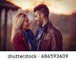 young lovely couple in autumn... | Shutterstock . vector #686593609
