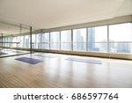 empty yoga studio and cityscape | Shutterstock . vector #686597764