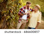 smiling father and son vintner... | Shutterstock . vector #686600857