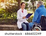 nurse with elderly man disabled ... | Shutterstock . vector #686602249