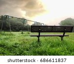 bench and swing set frame in an ... | Shutterstock . vector #686611837