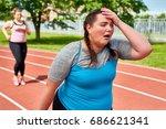 exhausted runner touching her...   Shutterstock . vector #686621341