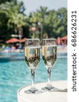 glasses of champagne in the pool   Shutterstock . vector #686626231