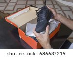 opening the box of a new pair... | Shutterstock . vector #686632219
