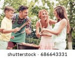barbecue time.mother father and ... | Shutterstock . vector #686643331