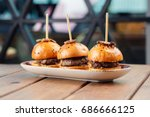 small burgers served on one... | Shutterstock . vector #686666125