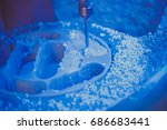 Small photo of Dental milling machine carving out shape of human teeth close-up