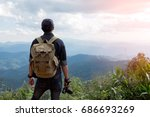 man traveler with photo camera... | Shutterstock . vector #686693269