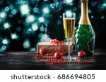 champagne glass and bottle over ... | Shutterstock . vector #686694805