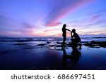 silhouette of the couple while... | Shutterstock . vector #686697451
