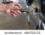 hand press to unlock the car... | Shutterstock . vector #686702125