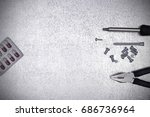 tools over a silver background | Shutterstock . vector #686736964