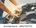 auto mechanic checking the oil... | Shutterstock . vector #686743741
