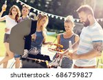 friends having barbecue party... | Shutterstock . vector #686759827