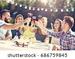 friends having barbecue party... | Shutterstock . vector #686759845