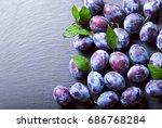 fresh blue plums on dark table  ... | Shutterstock . vector #686768284