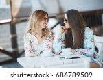 two beautiful young girls... | Shutterstock . vector #686789509